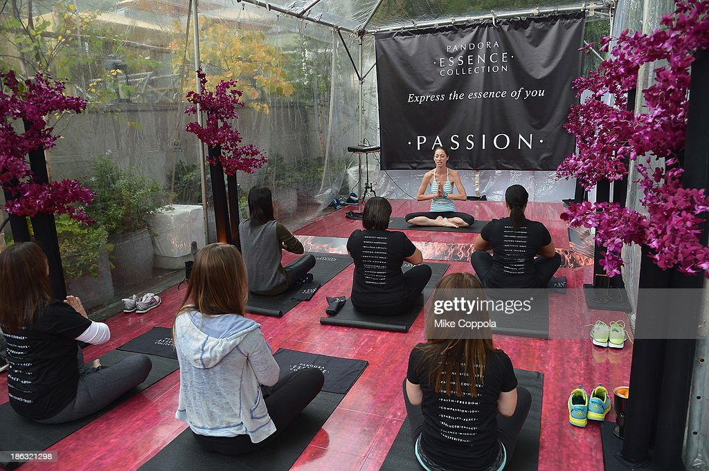 Yoga instructor Tara Stilesleads a yoga class at the Pandora Essence Collection Media Launch at The James New York on October 30, 2013 in New York City.