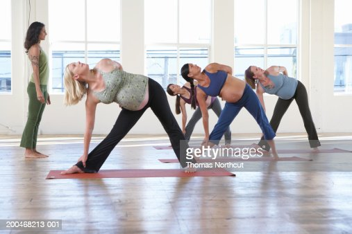 Yoga Instructor Teaching Four Pregnant Women In Yoga Class ...