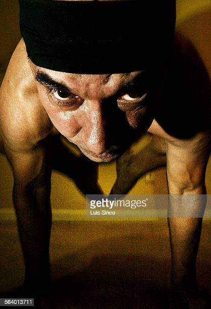 Yoga master Bikram Choudhury assumes a posture known as 'the crow'