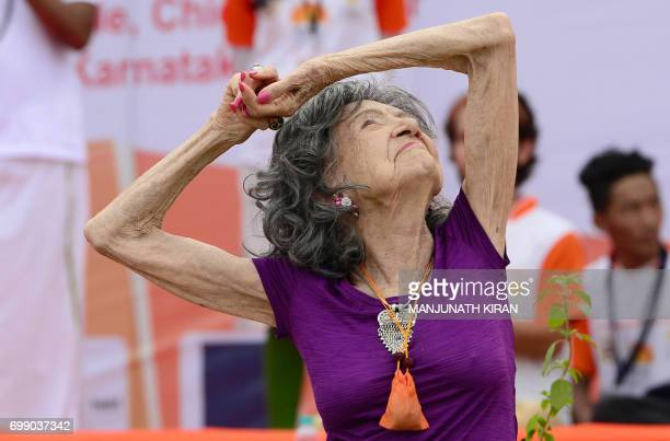 Yoga master Tao PorchonLynch takes part in a mass yoga session on International Yoga Day at the Shree Kanteerava Stadium in Bangalore on June 21 2017...