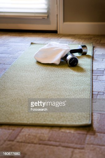 Yoga Mat and Free Weights on Carpet