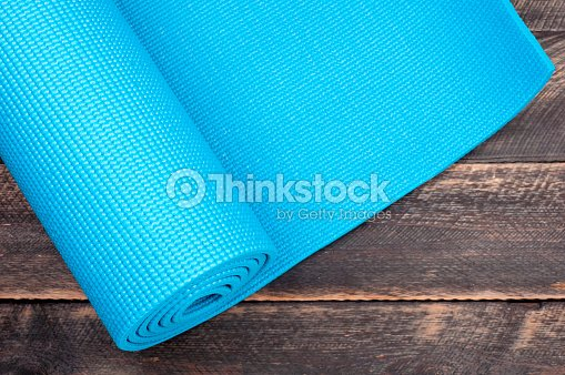 3f080b367aa9b Yoga mat on a wooden background. Equipment for yoga. Concept healthy  lifestyle. Copyspace