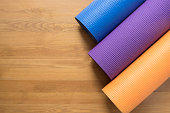 Yoga mats on the wood table