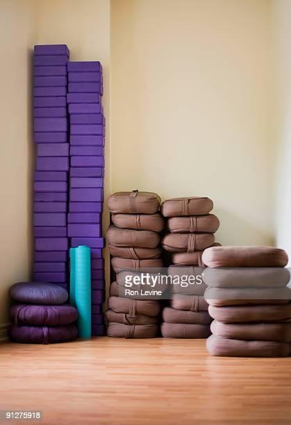 Yoga matt, blocks and pads in a yoga studio