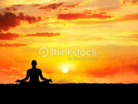Yoga meditation at sunset : Stock Photo