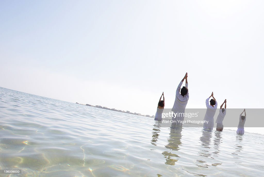 Yoga prayer in beach