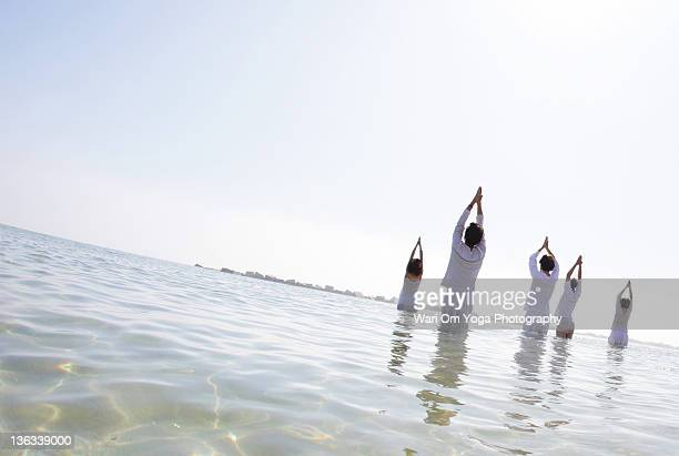 Yoga prayer in beach