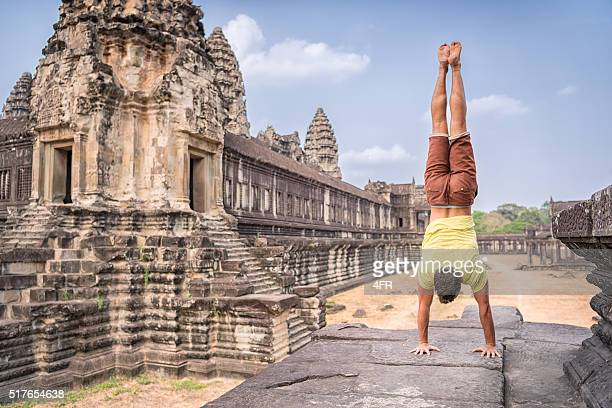 Yoga Retreat, Handsome man doing a Handstand, Angkor Wat