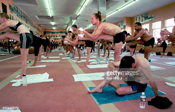 Yoga student Tom Grant sits on the floor and takes a break during Bikram Choudhury's yoga class in heated room Beverly Hills California February 2...