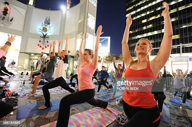 Yoga students and teachers participate in a free outdoor yoga class to celebrate Earth Day in the forecourt of the TCL Chinese Theatre formerly the...