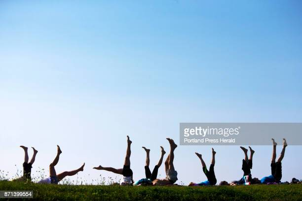 Yoga students point their toes skyward during a weekly session at Kettle Cove The donationbased classes are held on Fridays at 8 am The donations are...