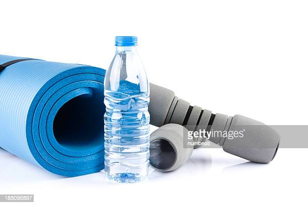 Yoga supplies - blue mat, water bottle and hand weights