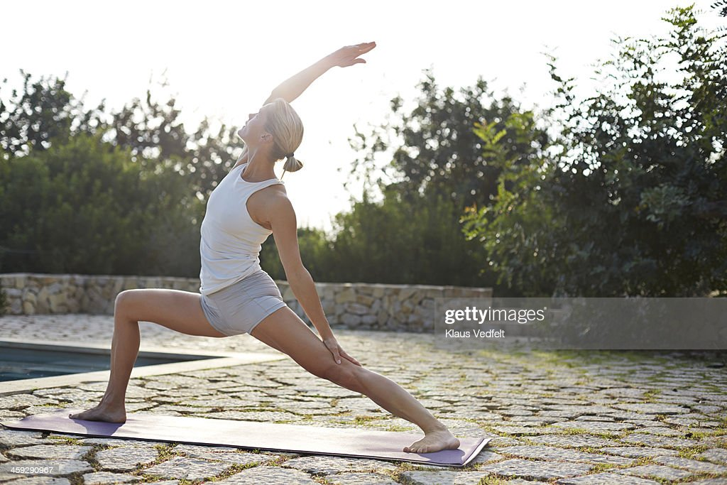 Yoga teacher doing Virabhadrasana (Warrior Pose)