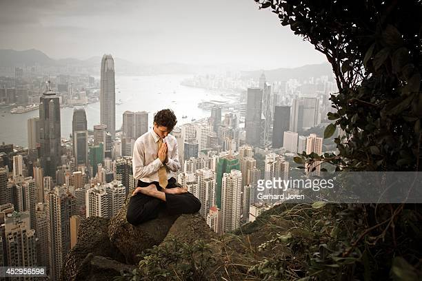 A yoga teacher performs a yoga pose at the Peak overlooking Central in Hong Kong MODEL RELEASED