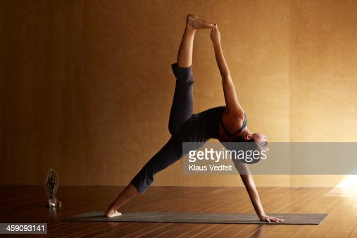 Yoga teacher posing a standing split
