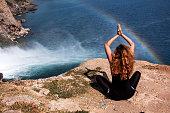 Yoga that women and rainbow.