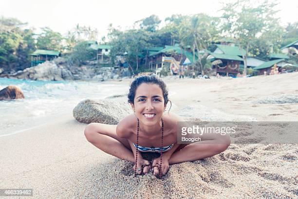 Yoga Woman Leaning Forward on Tropical Thailand Beach