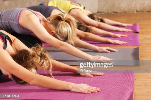 Yoga Workout Class, Group of Young Women Practicing Child Pose