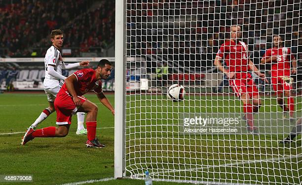 Yogan Santos of Gibraltar scores an own goal watched by Thomas Mueller of Germany to make it 40 during the EURO 2016 Group D Qualifier match between...