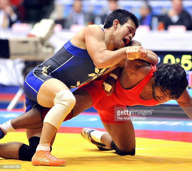Yogeshwar Dutt of India and Noriyuki Takatsuka of Japan compete in the Men's Freestyle 60kg final during the 2008 Asian Wrestling Championships at...
