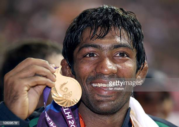 Yogeshwar Dutt of India celebrates after winning a gold medal in the men's 60KG Wrestling at IG Sports Complex during day six of the Delhi 2010...