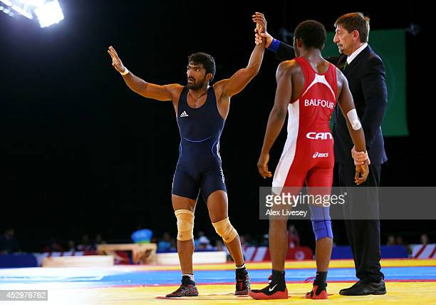 Yogeshwar Dutt of India celebrates victory in the Men's FS 65 kg Gold medal match against Jevon Balfour of Canada at Scottish Exhibition and...