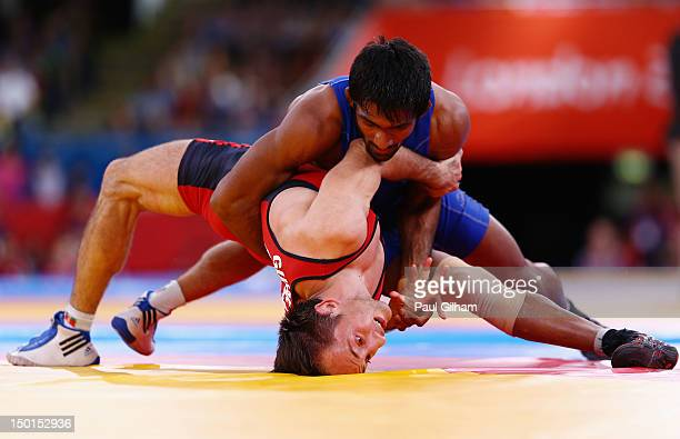 Yogeshwar Dutt of India in action against Anatolie Ilarionovitch Gudea of Bulgaria in the Men's Freestyle Wrestling 60kg qualification match on Day...