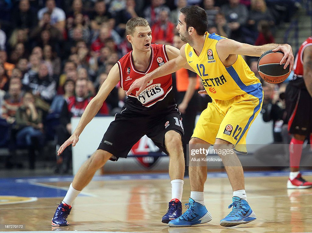 Yogev Ohayon, #12 of Maccabi Electra Tel Aviv competes with Renaldas Seibutis, #10 of Lietuvos Rytas Vilnius during the 2013-2014 Turkish Airlines Euroleague Regular Season Date 4 game between Lietuvos Rytas Vilnius v Maccabi Electra Tel Aviv at Siemens Arena on November 7, 2013 in Vilnius, Lithuania.