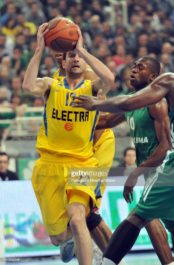 Yogev Ohayon, #12 of Maccabi Electra Tel Aviv competes with <a gi-track='captionPersonalityLinkClicked' href=/galleries/search?phrase=Romain+Sato&family=editorial&specificpeople=220873 ng-click='$event.stopPropagation()'>Romain Sato</a>, #10 of Panathinaikos Athens during the Turkish Airlines Euroleague Play Off C Game Day 1 between Panathinaikos Athens v Maccabi Electra Tel Aviv at OAKA on March 20, 2012 in Athens, Greece.