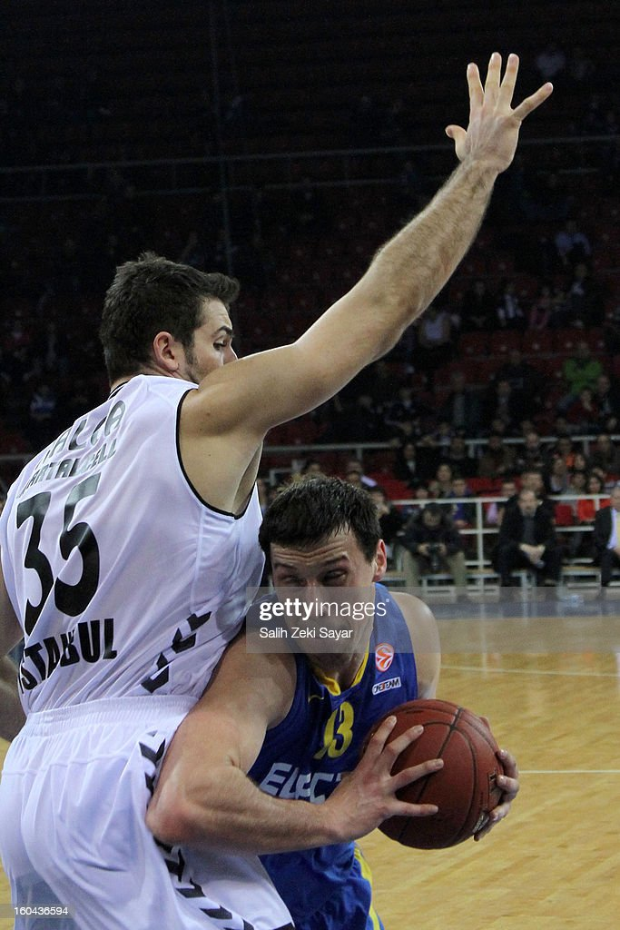 Yogev Ohayon #13 of Maccabi Electra competes with Cemal Nalga #35 of Besiktas JK Istanbul during the 2012-2013 Turkish Airlines Euroleague Top 16 Date 6 between Besiktas JK Istanbul v Maccabi Electra Tel Aviv at Abdi Ipekci Sports Arena on January 31, 2013 in Istanbul, Turkey.