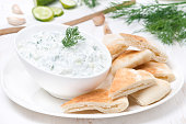 yoghurt sauce tzatziki with pieces of pita bread, close-up