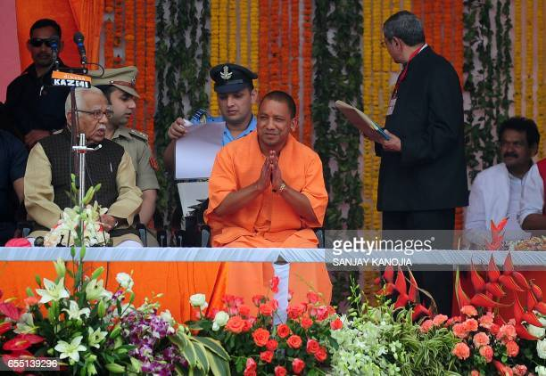 Yogi Adityanath Uttar Pradesh's new chief minister attends his swearingin ceremony in Lucknow on March 19 2017 Prime Minister Narendra Modi's...