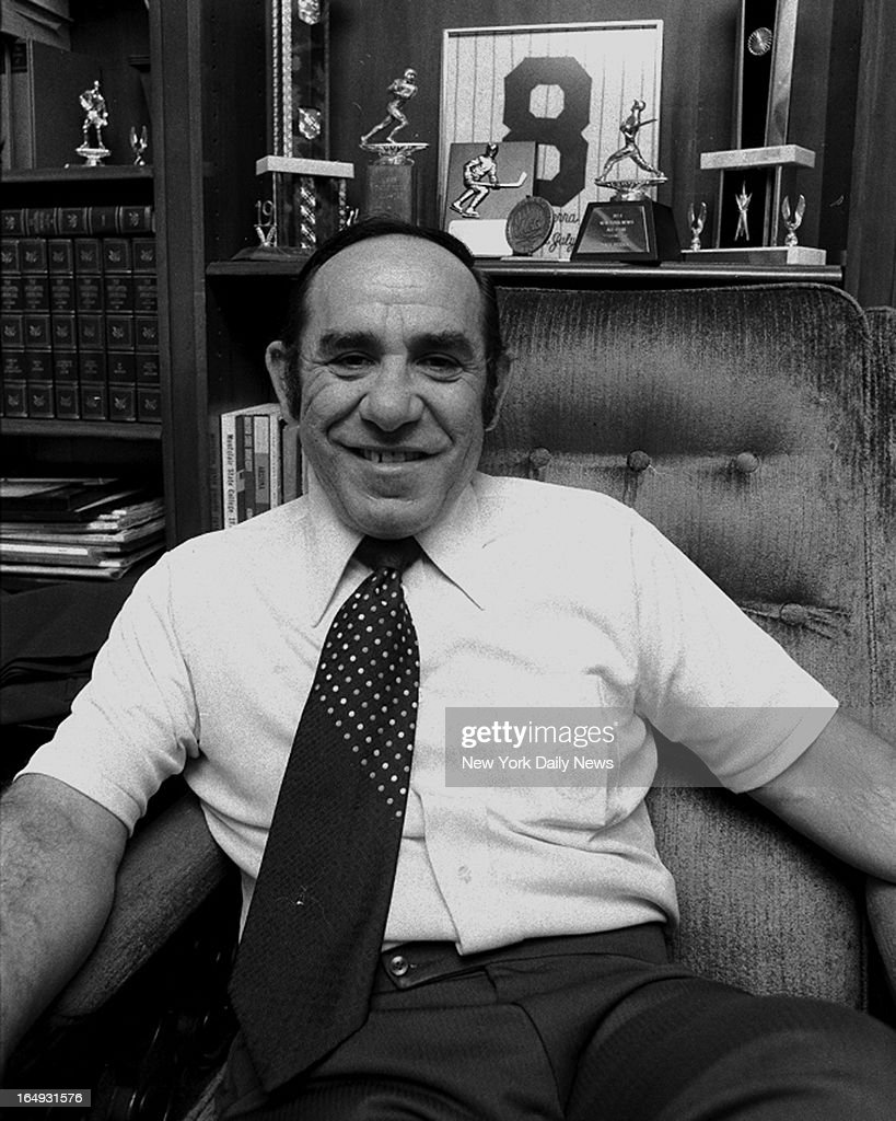 Yogi Berra the only man to lead both Yankees and Mets to the World Series seems relaxed among his soouvenirs at home in Montclair NJ He'll be paid...