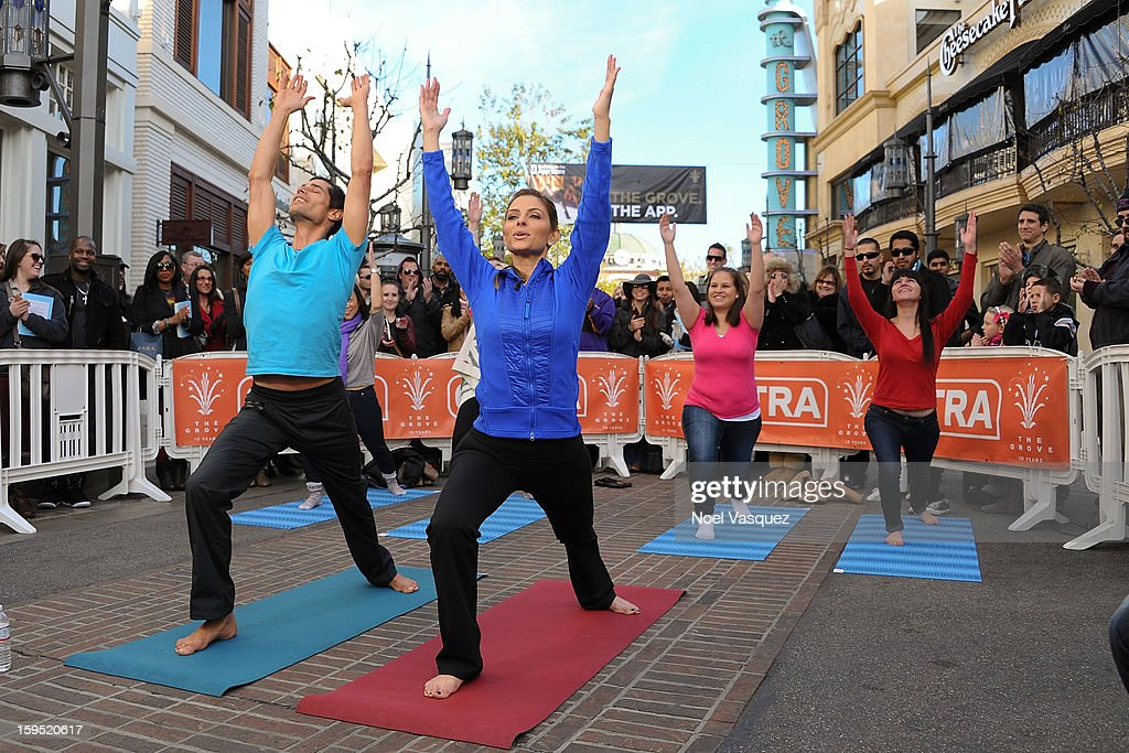 Yogi Cameron (L) and <a gi-track='captionPersonalityLinkClicked' href=/galleries/search?phrase=Maria+Menounos&family=editorial&specificpeople=203337 ng-click='$event.stopPropagation()'>Maria Menounos</a> practice yoga at Extra at The Grove on January 14, 2013 in Los Angeles, California.