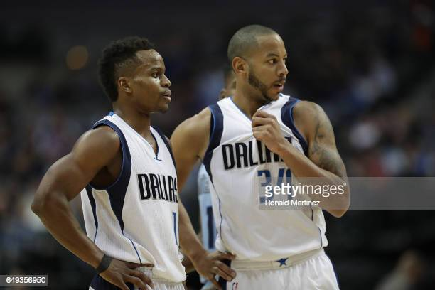 Yogi Ferrell and Devin Harris of the Dallas Mavericks at American Airlines Center on March 3 2017 in Dallas Texas NOTE TO USER User expressly...