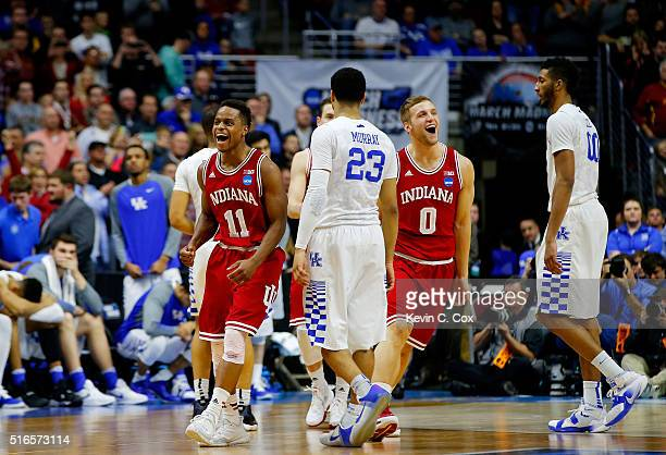 Yogi Ferrell and Max Bielfeldt of the Indiana Hoosiers celebrate defeating Kentucky Wildcats 73 to 67 during the second round of the 2016 NCAA Men's...