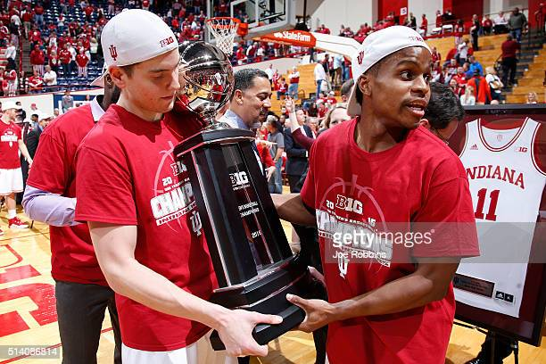 Yogi Ferrell and Nick Zeisloft of the Indiana Hoosiers hold the Big Ten Championship trophy following the game against the Maryland Terrapins at...