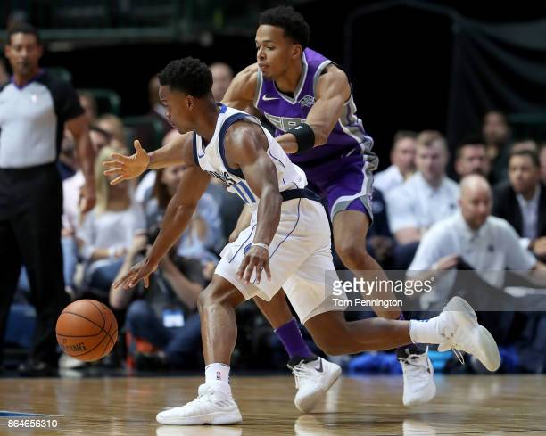 Yogi Ferrell of the Dallas Mavericks dribbles the ball against Skal Labissiere of the Sacramento Kings at American Airlines Center on October 20 2017...