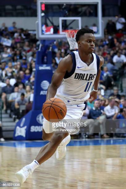 Yogi Ferrell of the Dallas Mavericks dribbles the ball down court against the Sacramento Kings at American Airlines Center on October 20 2017 in...