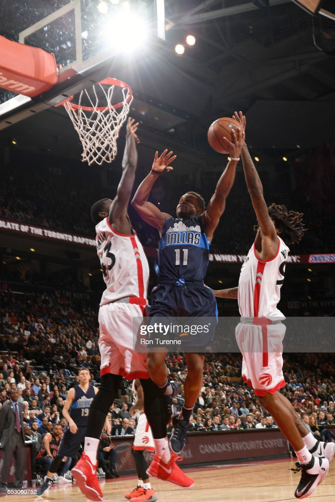 Yogi Ferrell #11 of the Dallas Mavericks goes to the basket against the Toronto Raptors on March 13, 2017 at the Air Canada Centre in Toronto, Ontario, Canada.
