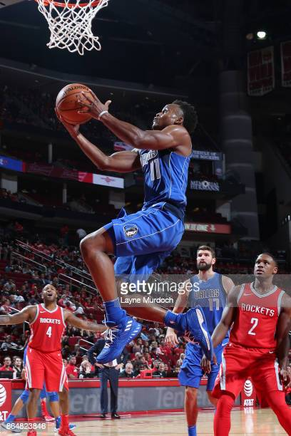 Yogi Ferrell of the Dallas Mavericks goes to the basket against the Houston Rockets on October 21 2017 at the Toyota Center in Houston Texas NOTE TO...