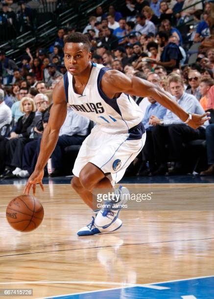 Yogi Ferrell of the Dallas Mavericks handles the ball against the Denver Nuggets during the game on April 11 2017 at the American Airlines Center in...