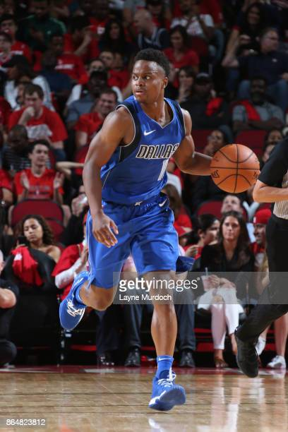 Yogi Ferrell of the Dallas Mavericks handles the ball against the Houston Rockets on October 21 2017 at the Toyota Center in Houston Texas NOTE TO...