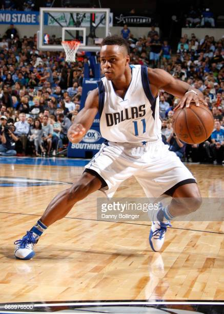 Yogi Ferrell of the Dallas Mavericks handles the ball against the San Antonio Spurs during the game on April 7 2017 at the American Airlines Center...