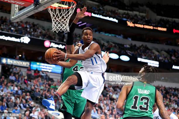 Yogi Ferrell of the Dallas Mavericks passes the ball against Al Horford of the Boston Celtics and James Young of the Boston Celtics in the second...