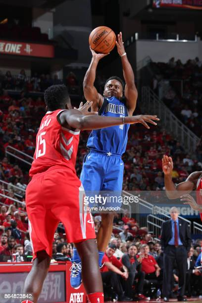 Yogi Ferrell of the Dallas Mavericks shoots the ball against the Houston Rockets on October 21 2017 at the Toyota Center in Houston Texas NOTE TO...