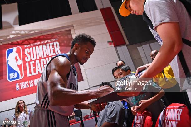 Yogi Ferrell of the Dallas Mavericks signs autographs for fans after the 2017 Las Vegas Summer League game against the Miami Heat on July 11 2017 at...
