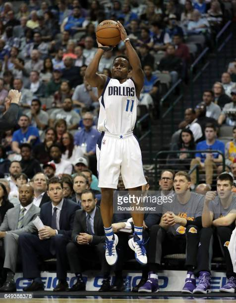Yogi Ferrell of the Dallas Mavericks takes a shot against the Los Angeles Lakers at American Airlines Center on March 7 2017 in Dallas Texas NOTE TO...