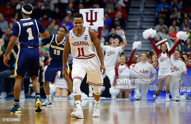 Yogi Ferrell of the Indiana Hoosiers celebrates a 3point basket against the Chattanooga Mocs in the second half during the first round of the 2016...