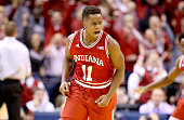 Yogi Ferrell of the Indiana Hoosiers celebrates after making a three point basket in the 8073 win against the Notre Dame Fighting Irish during the...
